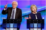 Hillary Rodham Clinton, right, and Sen. Bernie Sanders, of Vermont, speak during the CNN Democratic presidential debate Tuesday, Oct. 13, 2015, in Las Vegas. (AP Photo/John Locher)
